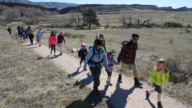 Volunteer master naturalist Barb Kittell, left, leads a hike at Bobcat Ridge Natural Area on Wednesday.