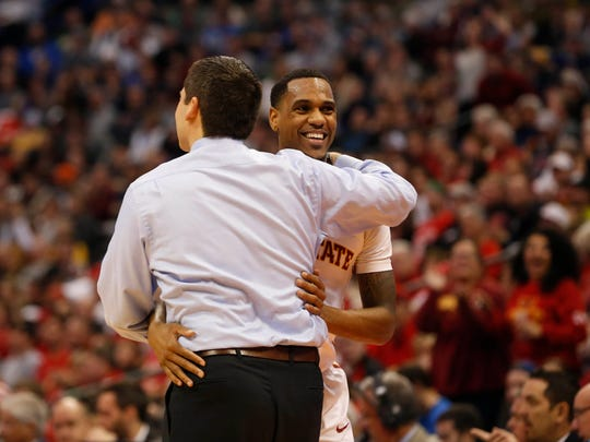 Iowa State guard Monte Morris (11) hugs coach Steve Prohm as he comes off the court Saturday, March 19, 2016, during second round of the NCAA men's basketball tournament at the Pepsi Center in Denver.