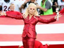 Lady Gaga sings the National Anthem on Sunday at Super Bowl 50 at Levi's Stadium in Santa Clara, California.