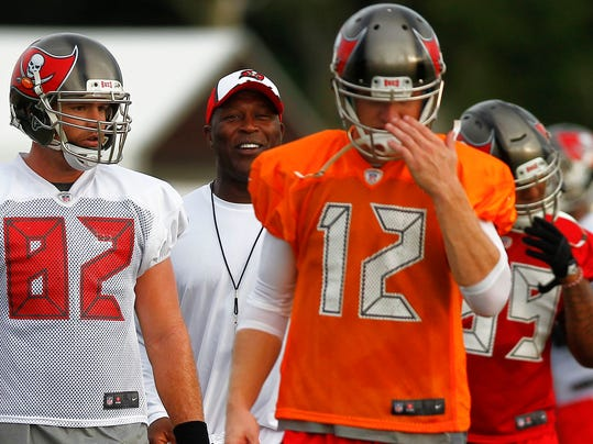 Tampa Bay Buccaneers coach Lovie Smith walks on the field with Brandon Myers (82) and Josh McCown (12) during the NFL football team's training camp Friday, July 25, 2014, in Tampa, Fla. (AP Photo/Tampa Bay Times, Eve Edelheit)