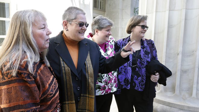 Plaintiffs challenging Oklahoma's gay marriage ban arrive at the U.S. Court of Appeals for the 10th Circuit in Denver for April's oral arguments.