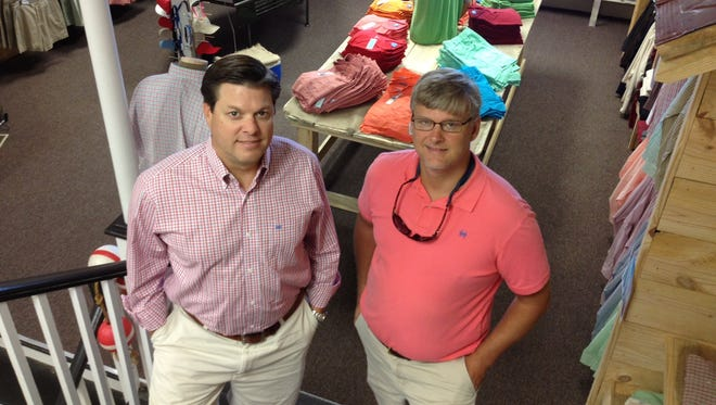 Chad Odom, left and Blayne Henderson, owners of Greenville-based COAST Apparel, are opening a retail store in Greenville this week.