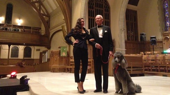 Sammy Wilson and Jay Holmes model with Holmes' Standard Poodle named Rochester at Fashion Week 2013.
