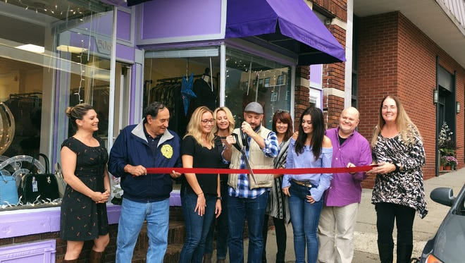 Boonton Mayor Matt DiLauri cuts the ribbon for the Grand Opening of Lunar Boutique in Boonton. Alderman Cy Wekilsky and Bob Tullock, Boonton Main Street President Patti Bujtas and Executive Director Chris Manzella joined owner Alexandra Luciano (third from right) and her mother Lisa Luciano and friends for the happy celebration.