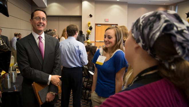 Timothy Wentworth, left, at the announcement of his $2.25 million gift to Monroe Community College on Thursday.
