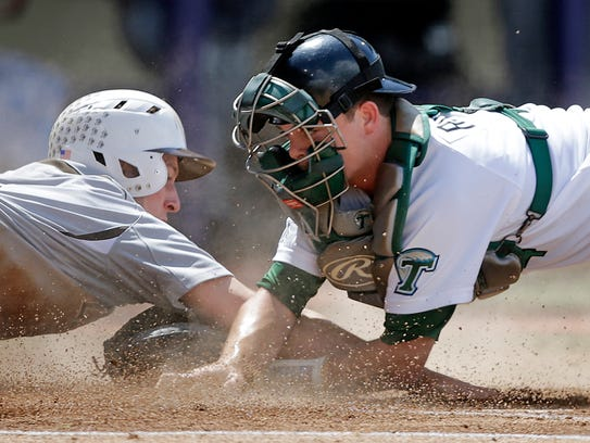 Jake Rogers catching for Tulane.
