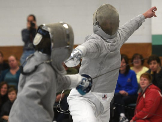 Evan Shoemaker of Butler (left) and Paul Schrope of Kinnelon fence a sabre bout on Wednesday, December 27, 2017.