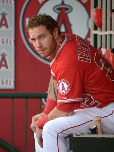 Josh Hamilton watches in the dugout during the game