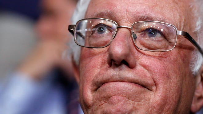 Former Democratic presidential candidate, Sen. Bernie Sanders, I-Vt., waits before asking that Hillary Clinton become the unanimous choice for President of the United States with the Vermont delegation during the second day session of the Democratic National Convention Tuesday in Philadelphia.