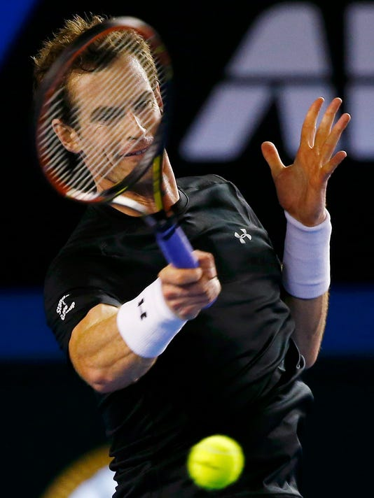 Andy Murray of Britain hits a return against Grigor Dimitrov of Bulgaria during their men's singles fourth round match at the Australian Open 2015 tennis tournament in Melbourne