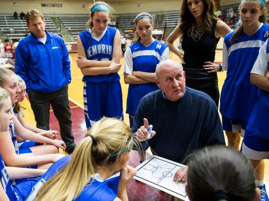 Memorial Head Coach Bruce Dockery talks to his team during a first quarter timeout in the IHSAA Class 3A sectional semifinal.