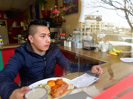 Freddy Calo, a permanent resident, has lunch at Belen Deli on Tuesday afternoon in Palisades Park. Calo said that even though he has his papers, he is worried about others that don't.