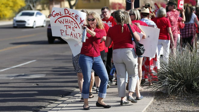 Teachers protest outside the KTAR studios in Phoenix on April 10, 2018. Gov. Doug Ducey was making an appearance at the studios.