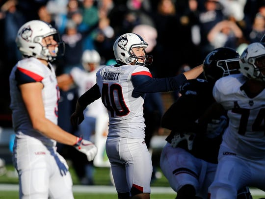 Connecticut Huskies place kicker Michael Tarbutt (40)