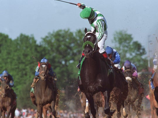 Winning jockey Victor Espinoza reacted after crossing the finish line on War Emblem. The colt became the only horse sold after his final prep to win the Derby in modern times.