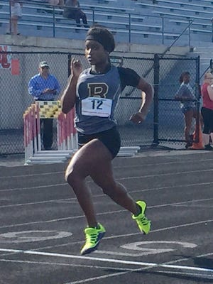 Brebeuf Jesuit sophomore Semira Killebrew wins a 100-meter heat at the North Central Sectional.