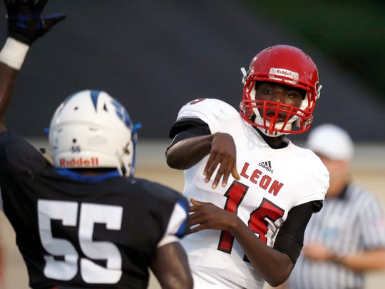 Leon quarterback Tyhran Glasco throws the ball over Godby's Kani Daguerre at Cox Stadium on Friday.