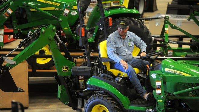 Steve Higgins parks John Deere equipment in preparation for last year's Texas Farm Ranch Wildlife Expo.