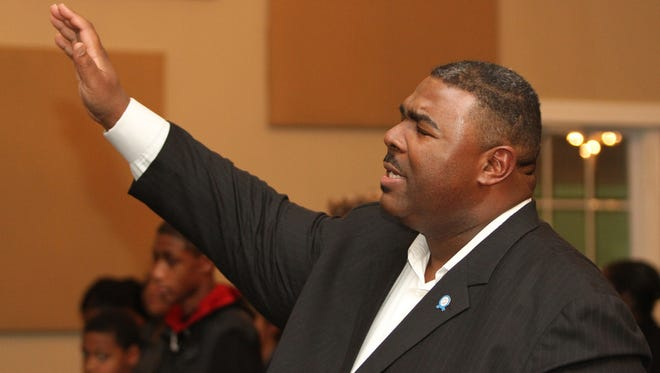 In this file photo, Pastor Trevon Gross of Hope Cathedral Church in Jackson prays during a Sandy grief relief seminar at the cathedral. Gross has been found guilty of accepting bribes and other crimes.