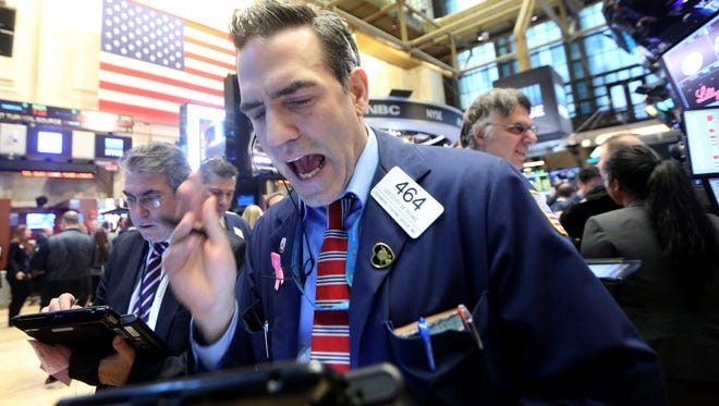 Traders work on the floor of the New York Stock Exchange on Friday in New York.