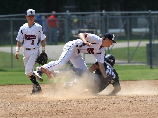 Marshfield's Hunter Luepke slides into second base