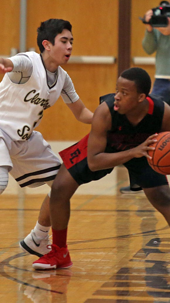 Clarkstown South's Kevin Downes (3) guards Fox Lane's