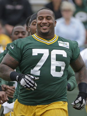 Green Bay Packers defensive tackle Mike Daniels smiles during minicamp at Ray Nitschke Field in June.