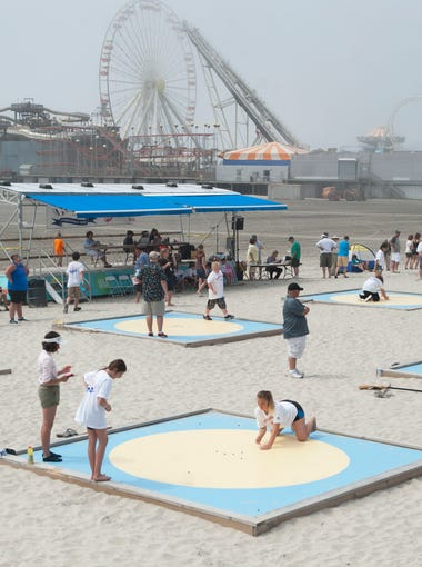 Participants compete in the National Marbles Tournament in Wildwood on Monday, June 18, 2018. The tournament is celebrating its 95th year.