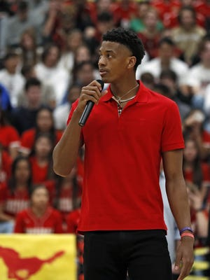 Jarrett Culver, a former Texas Tech standout, talks to the crwod during a ceremony for his retired jersey Feb. 18 at Coronado High School in Lubbock. Culver, who plays for the Minnesota Timberwolves, flew back to Lubbock to see his family a few weeks ago, which was when he recorded the PSA.