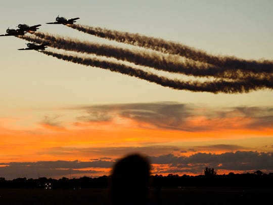 Pilots fly at twilight Oct. 30, 2015, at the Stuart AIr Show's Dirty Flight Suit Party at Witham Field.