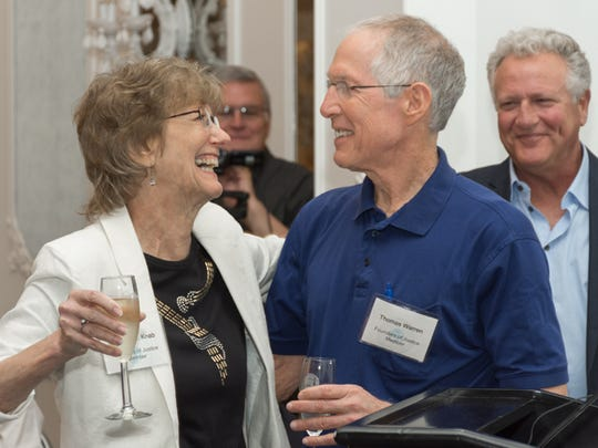 Kris Knab and Tommy Warren at celebration in honor of Knab's retirement from Legal Services of North Florida in 2016.