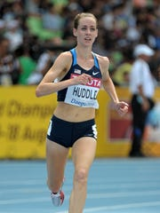 Molly Huddle runs in a women's 5,000 eter heat during