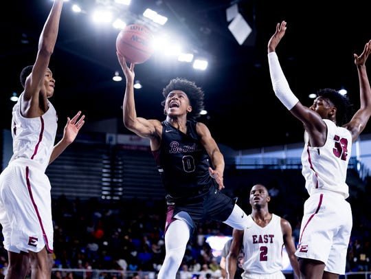 Bearden's Ques Glover (0) goes for a layup past the