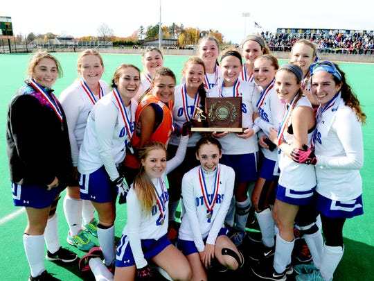 Otter Valley High School celebrates its 1-0 victory over Mount Abraham Union High School the Field Hockey Division 2 State Championship game at the University of Vermont on Saturday, October 31, 2015. (ALISON REDLICH/for the Free Press)