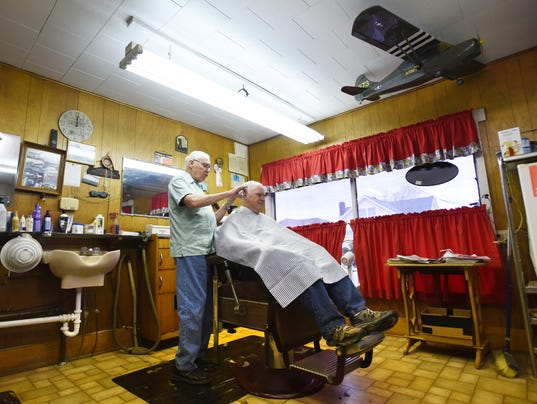 Barber Zanesville Ohio : With a model of one of his former airplanes hanging nearby, Tom Tyson ...