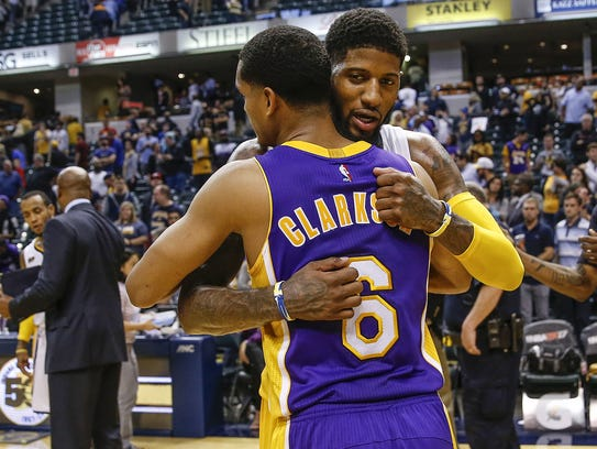 Indiana Pacers forward Paul George (13) gives a postgame