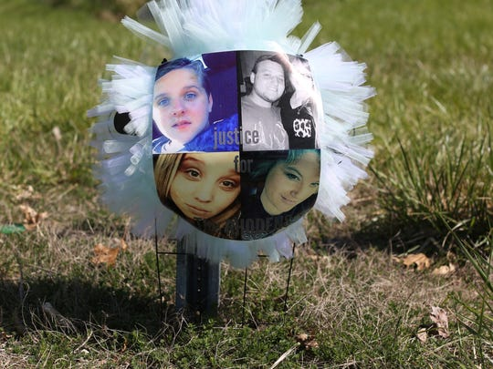 A small memorial at the intersection of Ohio 32 and Union Hill Road in Pike County honors some of the eight victims. Top left: Chris Rhoden, Frankie Rhoden and his fianceŽ, Hannah Gilley, Bottom left: Hanna Rhoden and her mom, Dana Rhoden.