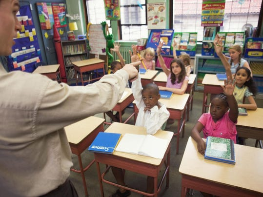 Teacher instructing class