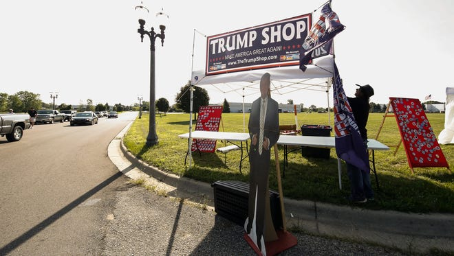 Tito Ferreira of Las Vegas readies his Trump Shop outside of The Summit Friday morning, August 19, 2016, where GOP presidential candidate Donald Trump is slated to speak early Friday evening.