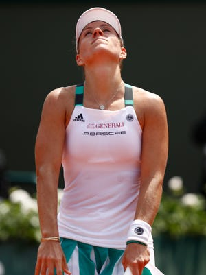 Angelique Kerber reacts during the ladies singles first-round match against Ekaterina Makarova in the first round.