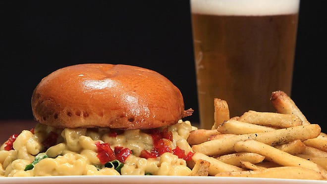 Chomp's Mac and Cheese Burger, as well as fries and beer, will be on the takeout menu at their new, second restaurant when it opens in Providence next week. Restaurant openings take on a new vibe during the coronavirus epidemic.