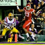 LSU Tigers safety Jamal Adams (33) intercepts a pass intended for Arkansas Razorbacks tight end Jeremy Sprinkle (83) during the second quarter of a game at Tiger Stadium.