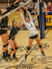 Hartland's Baylie Burgdorf plays the ball at the net against Brighton.