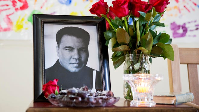 A photo of Muhammad Ali is displayed during an interfaith service Sunday at the Islamic Cultural Center of Louisville.
