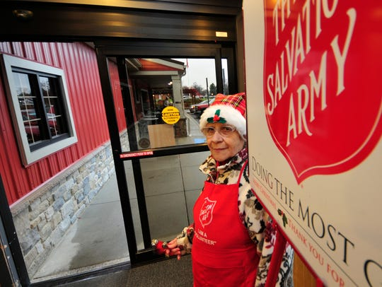 Marietta Smith rings the bell for the Salvation Army,