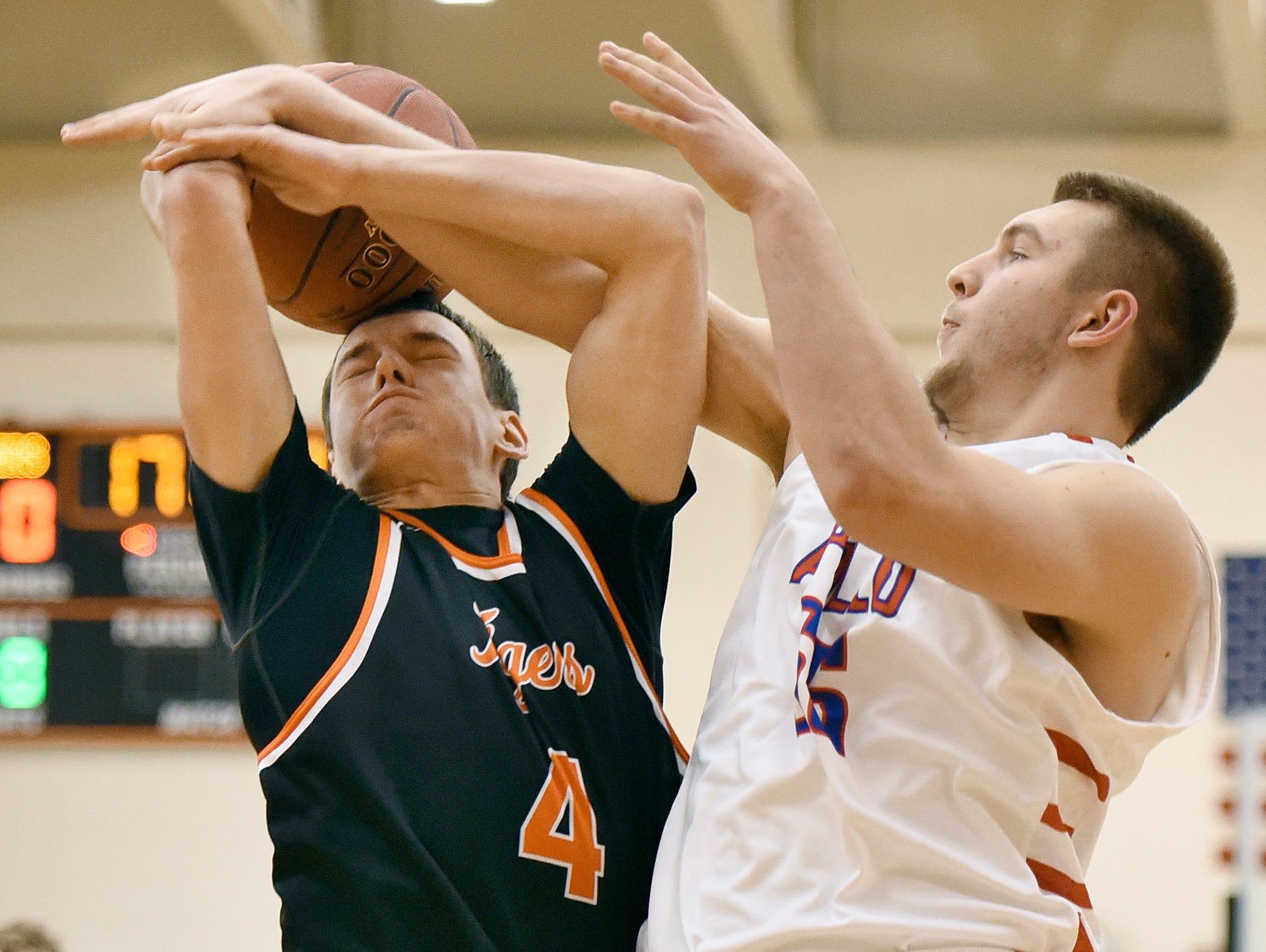 Tech's Max Martig has his shot blocked by Apollo's Luke Dunsmoor under the basket during the first half Tuesday Dec. 8 at Apollo High School.