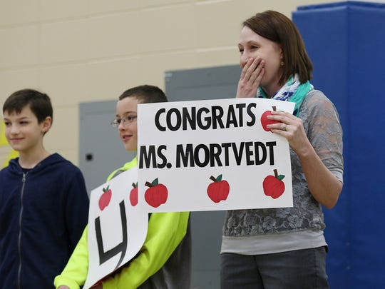 Third grade teacher Jennifer Mortvedt reacts after being announced as a Crystal Apple award winner in an all-school assembly at Nasonville Elementary School in Marshfield, Tuesday, May 5, 2016.