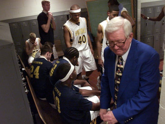 Charlie Anderson exits the lockerroom after giving his Aquinas College team a talk.