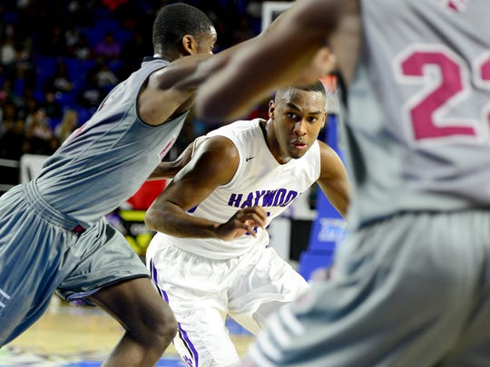 Haywood's Tristan Jarrett is guarded by a Maplewood