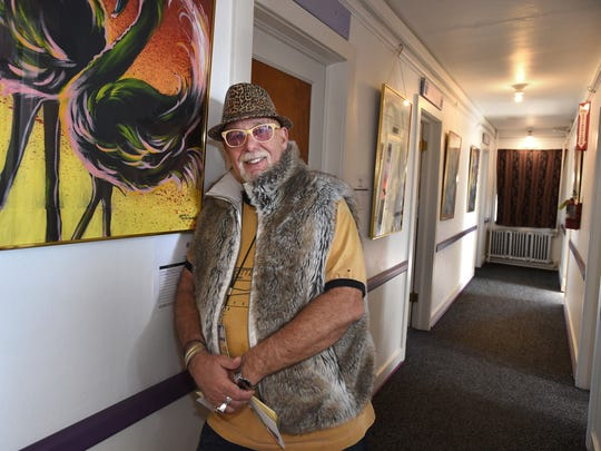 Jungle Jim Gibson, owner of the Morris Burner Hotel on E. Fouth Street, stands in a hallway of the burner hotel on Jan. 28, 2015.
